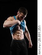 Купить «Cute young sports man in blue t-shirt shows relief abdominal muscles», фото № 28891351, снято 9 марта 2018 г. (c) Restyler Viacheslav / Фотобанк Лори