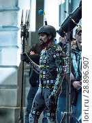 Купить «Film crew and stuntmen prepare for the filming of the upcoming movie 'Avengers: Infinity War' on the Royal Mile in Edinburgh Featuring: Stuntman Where...», фото № 28896907, снято 31 марта 2017 г. (c) age Fotostock / Фотобанк Лори