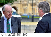 Sir Malcolm Rifkind, former Conservative MP and cabinet minister, being interviewed by BBC's Simon McCoy on College Green, Westminster July 2018. Редакционное фото, фотограф Phil Robinson / age Fotostock / Фотобанк Лори
