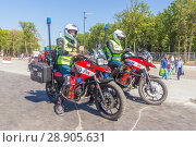Купить «Russia, Samara, June 2018: firefighters on special motorcycles equipped for fire fighting at the stadium of Samar arena in the match day of Serbia Costa Rica.», фото № 28905631, снято 17 июня 2018 г. (c) Акиньшин Владимир / Фотобанк Лори