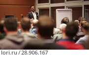Купить «Public speaker giving talk at business event», видеоролик № 28906167, снято 5 апреля 2020 г. (c) Matej Kastelic / Фотобанк Лори