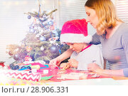 Купить «Teacher helping boy to decorate Christmas ornament», фото № 28906331, снято 31 декабря 2016 г. (c) Сергей Новиков / Фотобанк Лори
