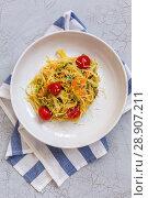 Купить «Linguine paste with strips of zucchini and carrots», фото № 28907211, снято 7 августа 2018 г. (c) Марина Сапрунова / Фотобанк Лори