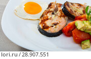 Купить «Roasted salmon, fried egg with vegetables on white plate», фото № 28907551, снято 22 августа 2018 г. (c) Яков Филимонов / Фотобанк Лори