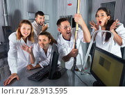 Купить «Adults laughing and grimacing in quest room-laboratory», фото № 28913595, снято 6 июля 2017 г. (c) Яков Филимонов / Фотобанк Лори