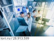 Купить «Guys and girls solve a puzzle in the laboratory», фото № 28913599, снято 6 июля 2017 г. (c) Яков Филимонов / Фотобанк Лори