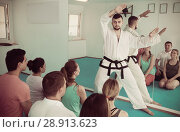 Купить «Karate coach teaching adults», фото № 28913623, снято 8 апреля 2017 г. (c) Яков Филимонов / Фотобанк Лори