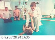 Купить «Young girls are training in pair to use taekwondo technique», фото № 28913635, снято 8 апреля 2017 г. (c) Яков Филимонов / Фотобанк Лори