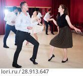 Купить «People dancing twist», фото № 28913647, снято 24 мая 2017 г. (c) Яков Филимонов / Фотобанк Лори