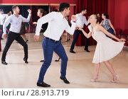 Купить «Dancing couples enjoying active dance», фото № 28913719, снято 24 мая 2017 г. (c) Яков Филимонов / Фотобанк Лори