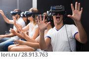 Купить «Excited man experiencing with friends virtual reality», фото № 28913763, снято 6 июля 2017 г. (c) Яков Филимонов / Фотобанк Лори