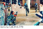 Купить «Teams faced on the battlefield in the arena of paintball.», фото № 28913779, снято 10 июля 2017 г. (c) Яков Филимонов / Фотобанк Лори