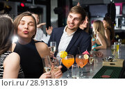 Купить «Two female colleagues are exchanging compliments to each other», фото № 28913819, снято 20 апреля 2017 г. (c) Яков Филимонов / Фотобанк Лори