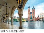 Купить «Beautiful open view of the main square of Krakow. Mary's church and arch in cloudy weather», фото № 28917219, снято 13 августа 2017 г. (c) Константин Лабунский / Фотобанк Лори