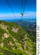 Купить «Vertical picture of cable car rope in Tatra, Poland», фото № 28917347, снято 19 августа 2017 г. (c) Константин Лабунский / Фотобанк Лори