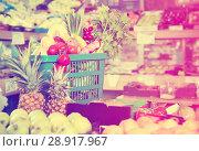 Купить «Shopping basket filled with fresh fruits and vegetables in store shelves», фото № 28917967, снято 14 октября 2017 г. (c) Яков Филимонов / Фотобанк Лори
