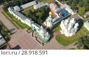 Купить «Flight of the camera over Saint Sophia orthodox cathedral and church of Resurrection of Jesus in a sunny summer day in Vologda Kremlin», видеоролик № 28918591, снято 9 августа 2018 г. (c) Mikhail Starodubov / Фотобанк Лори