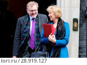 Купить «David Mundell, Secretary of State for Scotland, and Andrea Leadsom, Secretary of State for Environment Food and Rural Affairs, leaving the weekly cabinet...», фото № 28919127, снято 21 марта 2017 г. (c) age Fotostock / Фотобанк Лори
