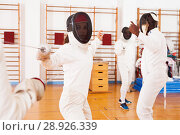 Купить «woman fencer practicing fencing combination», фото № 28926339, снято 11 июля 2018 г. (c) Яков Филимонов / Фотобанк Лори