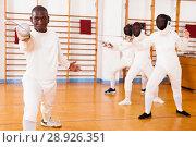 Купить «African american man fencer in training room», фото № 28926351, снято 11 июля 2018 г. (c) Яков Филимонов / Фотобанк Лори