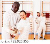 Купить «fencer practicing movements with african american trainer», фото № 28926355, снято 11 июля 2018 г. (c) Яков Филимонов / Фотобанк Лори