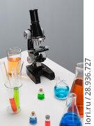 Купить «Test tubes on a table», фото № 28936727, снято 4 августа 2018 г. (c) Типляшина Евгения / Фотобанк Лори