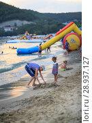 Купить «Children bathe in the sea», фото № 28937127, снято 6 июля 2018 г. (c) Типляшина Евгения / Фотобанк Лори