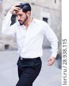 Купить «Macho man dancing solo outdoors», фото № 28938115, снято 5 августа 2017 г. (c) Яков Филимонов / Фотобанк Лори
