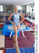 Купить «Happy beautiful woman gymnast training gymnastic action at broad bars», фото № 28938283, снято 18 июля 2018 г. (c) Яков Филимонов / Фотобанк Лори