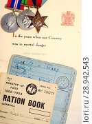 Купить «Ration books in use after World War Two to cope with post war shortages, belonging to a Cyril Ward, with a letter about his service in the Home Guard and his medals.», фото № 28942543, снято 25 июля 2018 г. (c) age Fotostock / Фотобанк Лори