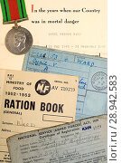 Купить «Ration books in use after World War Two to cope with post war shortages, belonging to a Cyril Ward, with a letter about his service in the Home Guard and his Defence Medal.», фото № 28942583, снято 25 июля 2018 г. (c) age Fotostock / Фотобанк Лори
