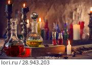 Купить «Magic potion, ancient books and candles», фото № 28943203, снято 4 августа 2017 г. (c) Майя Крученкова / Фотобанк Лори