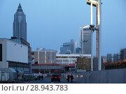 Купить «View from the Frankfurt Exhibition Center to the Messeturm in the evening», фото № 28943783, снято 12 февраля 2017 г. (c) Caro Photoagency / Фотобанк Лори