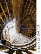 Купить «Wooden spiral staircase in the ancient bell tower of the Orthodox Church», фото № 28954459, снято 19 января 2019 г. (c) Mikhail Starodubov / Фотобанк Лори