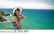 Купить «Woman enjoying her vacation», видеоролик № 28954491, снято 9 августа 2018 г. (c) Илья Шаматура / Фотобанк Лори