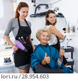 Купить «Hairstylists presenting result of styling to female client», фото № 28954603, снято 26 июня 2018 г. (c) Яков Филимонов / Фотобанк Лори