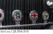 Купить «Vintage car front logotype in britain», видеоролик № 28954919, снято 9 августа 2018 г. (c) Aleksejs Bergmanis / Фотобанк Лори
