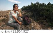 Купить «Tired woman traveler waching nature», видеоролик № 28954927, снято 9 августа 2018 г. (c) Илья Шаматура / Фотобанк Лори