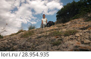 Купить «Woman traveler resting», видеоролик № 28954935, снято 9 августа 2018 г. (c) Илья Шаматура / Фотобанк Лори