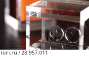 Купить «Silver Wedding Rings in the glass box macro closeup shoot diamon Jewellery», видеоролик № 28957011, снято 9 августа 2018 г. (c) Aleksejs Bergmanis / Фотобанк Лори