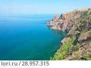 Купить «Lake Baikal in the summer. The northern extremity of Olkhon Island is Cape Khoboy. Small figures of tourists visiting the cliff - a natural landmark island», фото № 28957315, снято 14 июня 2011 г. (c) Виктория Катьянова / Фотобанк Лори