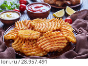 Купить «Crispy Potato Waffles Fries, close up», фото № 28957491, снято 31 июля 2018 г. (c) Oksana Zh / Фотобанк Лори