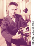 Купить «young calm man machinery operator working in winery», фото № 28958083, снято 16 августа 2018 г. (c) Яков Филимонов / Фотобанк Лори