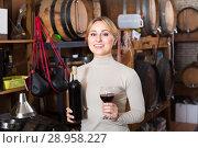 Купить «Woman selecting wine in wine house», фото № 28958227, снято 16 августа 2018 г. (c) Яков Филимонов / Фотобанк Лори