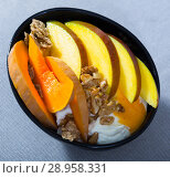 Купить «Mango and baked pumpkin with flakes and yogurt», фото № 28958331, снято 23 сентября 2018 г. (c) Яков Филимонов / Фотобанк Лори
