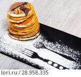 Купить «Pancakes with chocolate and walnuts», фото № 28958335, снято 23 августа 2019 г. (c) Яков Филимонов / Фотобанк Лори