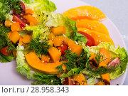 Купить «Tasty salad of baked pumpkin, cherry tomatoes, sesame and sauce», фото № 28958343, снято 21 августа 2018 г. (c) Яков Филимонов / Фотобанк Лори