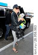 Купить «Heather Locklear at Los Angeles International Airport (LAX) with her little dog Featuring: Heather Locklear Where: Los Angeles, California, United States When: 19 Apr 2017 Credit: WENN.com», фото № 28958983, снято 19 апреля 2017 г. (c) age Fotostock / Фотобанк Лори