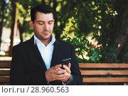 Купить «business man with smartphone in the park», фото № 28960563, снято 14 августа 2018 г. (c) Александр Лычагин / Фотобанк Лори