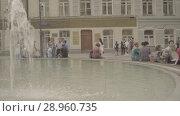Купить «People have a rest around the fountain near the Gostinniy Dvor in Moscow», видеоролик № 28960735, снято 25 июля 2018 г. (c) Ирина Мойсеева / Фотобанк Лори